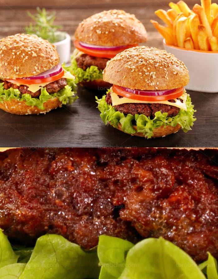 عکس با کیفیت ساندویچ همبرگر با نان گرد و سیب زمینی سرخ شده