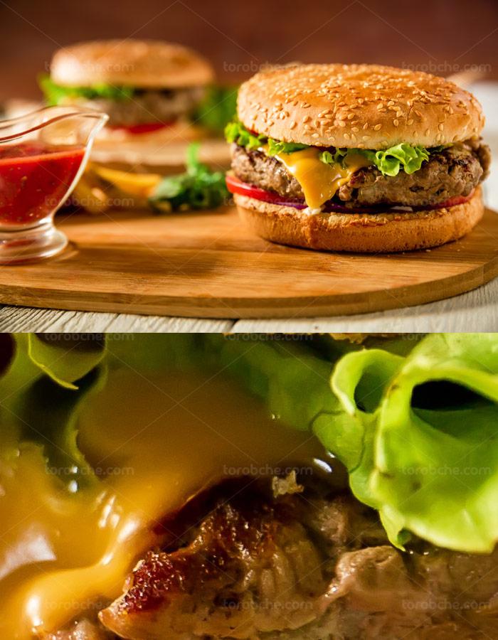 عکس با کیفیت همبرگر آمریکایی با نان کنجدی توست شده