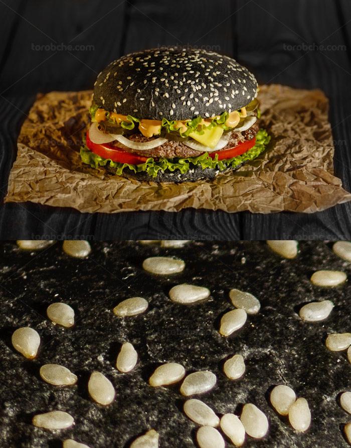 عکس با کیفیت همبرگر با نان مشکی کنجدی