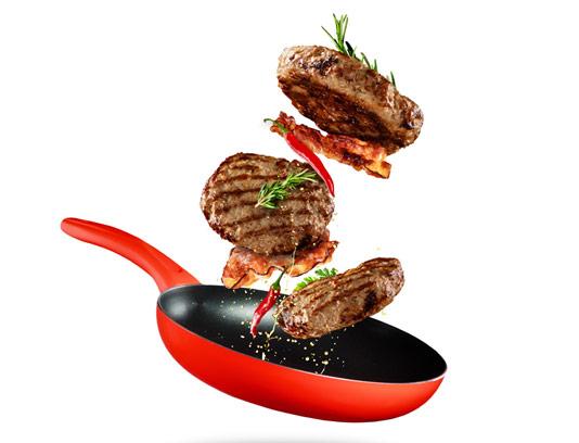 عکس با کیفیت همبرگرهای در حال سرخ شدن