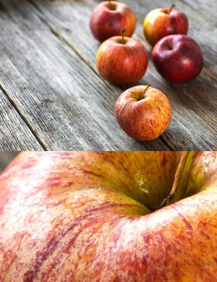 عکس با کیفیت سیب قرمز با بکگراند چوبی - گرافیک با طعم تربچه