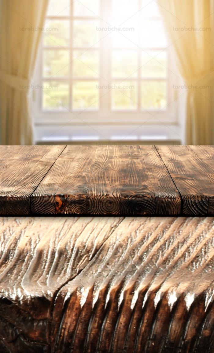 بکگراند و زمینه میز چوبی در کنار پنجره