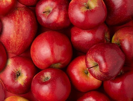 پس زمینه سیب قرمز و تازه